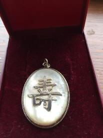 Solid Silver pendant with mother of pearl,