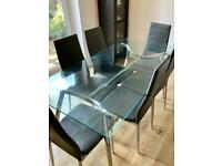 Glass table and 6 grey chairs