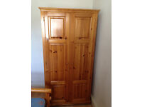 Good quality wardrobe in real pine wood with shelve and hanger bar