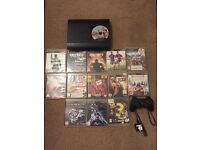 Playstation 3 with controller and 14 games