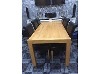 Real oak dining table and 6 leather chairs