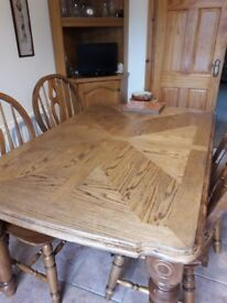 Solid wood table & 4 chairs £200 Excellent condition.