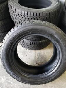 LIKE BRAND NEW  HIGH PERFORMANCE WINTER TIRE 235 / 60 / 18  SET OF FOUR. NO RIMS