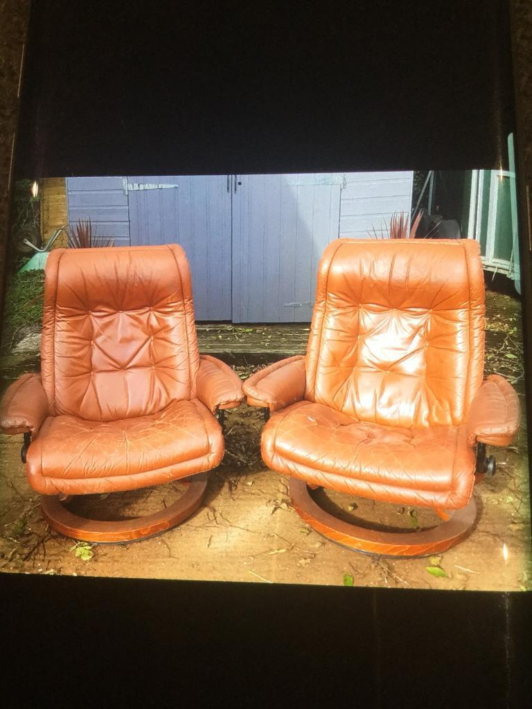 Two swivel leather look chairs