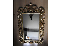 gilt framed ornater with roses wall mirror