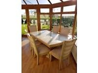 Solid hardwood table and 6 chairs.