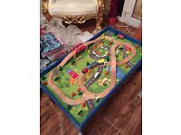 Kids Wooden train set and table..