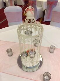 X11 birdcage wedding centrepieces with white and coral roses
