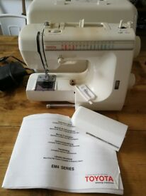 Toyota sewing machine EM4 series fully working. Comes w bits and bobs - see photos.