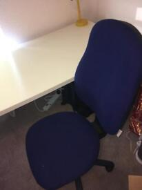 White desk and swivel chair