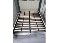 White leather double bed.