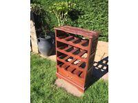 Ornamental dark hard wood wine rack
