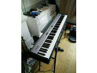 Roland FP-2 digital piano keyboard