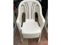 Four white stackable garden chairs for sale
