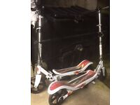 Have 2 space scooters look new