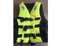 Brand new life jacket- black and yellow.