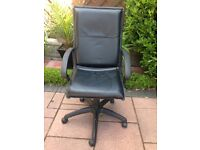 Black leather office/study swivel armchair with adjustable height lever.