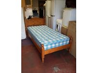 solid pine single bed with 8 inch thick mattress