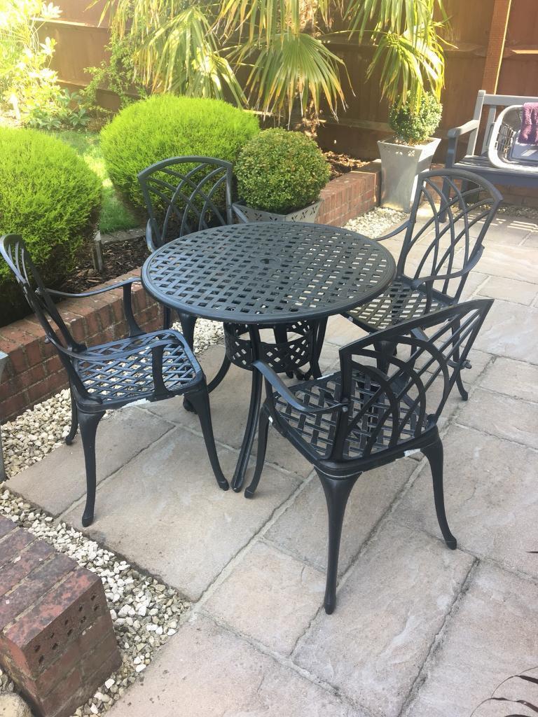 Gun metal grey metal patio table and chairs