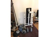 Weights bench, bars and assorted weight discs.