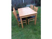 Oak veneered dining table & chairs