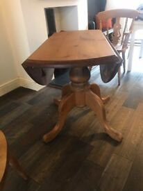 Farmhouse style solid wood drop leaf table and 4 matching chairs