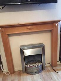 Electric fire and pine surround