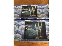 2 sets of cut lead crystal wine and champagne glasses