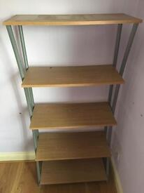Shelving unit oak colour.