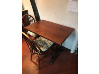 Lovely solid oak dining/kitchen table with two wheelback chairs.