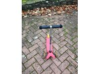 Used Pink Micro Scooter with Yellow Break on the back wheel. Good condition.
