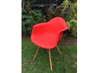 Eames style red plastic bucket chair