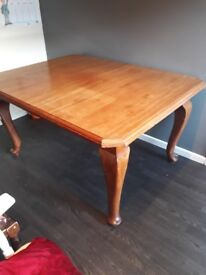Antique table over 80 yrs old solid oak seats 6 extends also