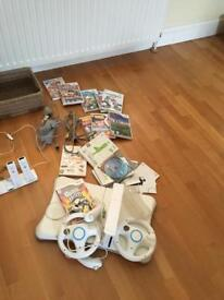 Nintendo Wii Console controllers wheel Wii fit board and selection of games £60.00.
