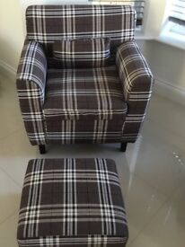 Brown checkered arm chair and foot stool