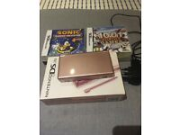 Almost new Nintendo DS Lite (pink) with original packaging and games