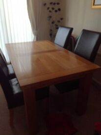 Oak table 150long 90 wide + extensions, 6 chairs (2 with scratches)