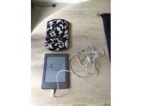 Amazon Kindle and smart holder. Unwanted gift