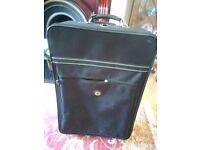 Suitcase. Large, black, strong. By Carlton International.