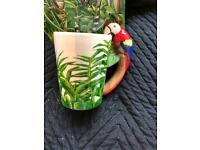 Mug with a macaw shaped handle stunning