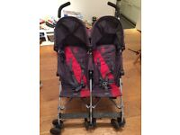 Maclaren Twin Triumph, used double pushchair, comes with rain cover.