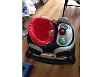 Childs red race car walker/bouncer