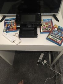 Black wii u in excellent condition comes with game pad