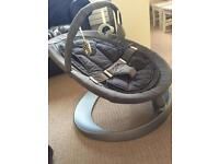 Nuna Leaf Curve rocker chair with NEW toy bar. Excellent condition, with newborn insert & toy bar.