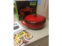 Brand new Cast iron with red enamel Dutch oven.