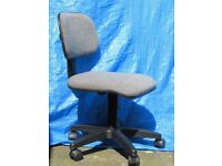 Grey swivel child's desk chair on castors with adjustable back height