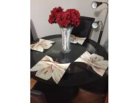 Black Glass dinning table with 4 leather chairs in good condition