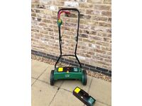24v rechargeable lawn mower as new with two batteries surplus to grass