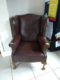 Wing back chair brown.
