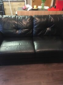 Two three seater black leather sofa £100